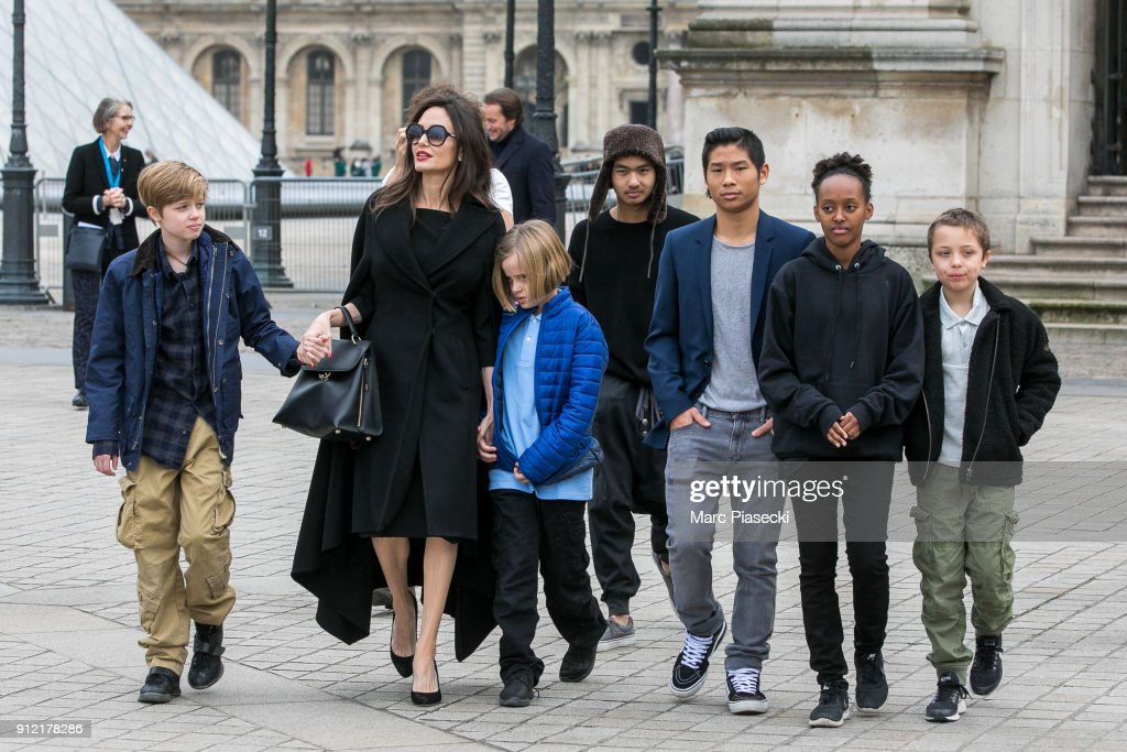 Actress Angelina Jolie and her children Maddox Jolie-Pitt, Shiloh Jolie-Pitt, Vivienne Marcheline Jolie-Pitt, Knox Leon Jolie-Pitt, Zahara Jolie-Pitt and Pax Jolie-Pitt are seen leaving the Louvre museum on January 30, 2018 in Paris, France.