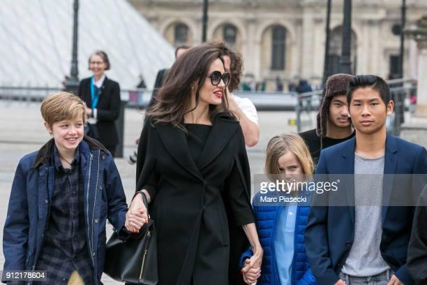 Actress Angelina Jolie and her children Maddox JoliePitt Shiloh JoliePitt Vivienne Marcheline JoliePitt and Pax JoliePitt are seen leaving the Louvre...