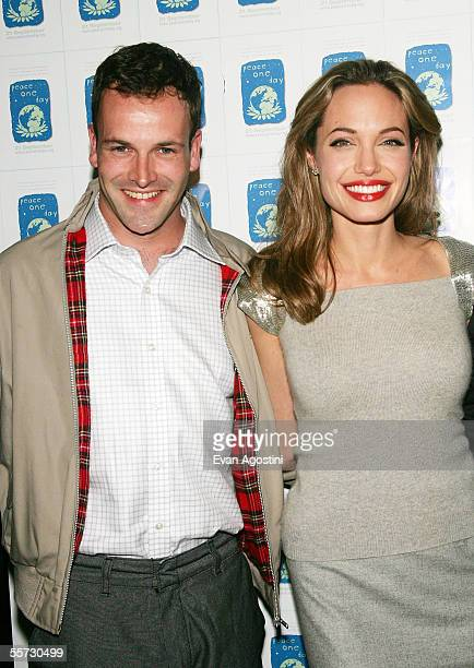 Actress Angelina Jolie and her exhusband Jonny Lee Miller attend a special screening of the film 'Peace One Day' at the Ziegfeld Theater September 20...