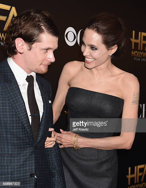 Actress Angelina Jolie and honoree Jack O'Connell attend the 18th Annual Hollywood Film Awards at The Palladium on November 14 2014 in Hollywood...