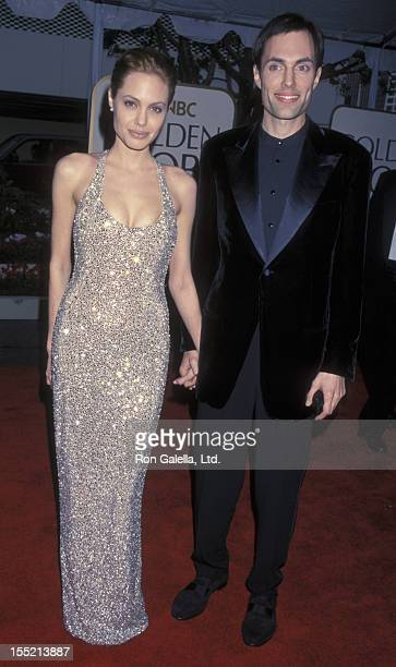 Actress Angelina Jolie and James Haven attend 56th Annual Golden Globe Awards on January 24 1999 at the Beverly Hilton Hotel in Beverly Hills...