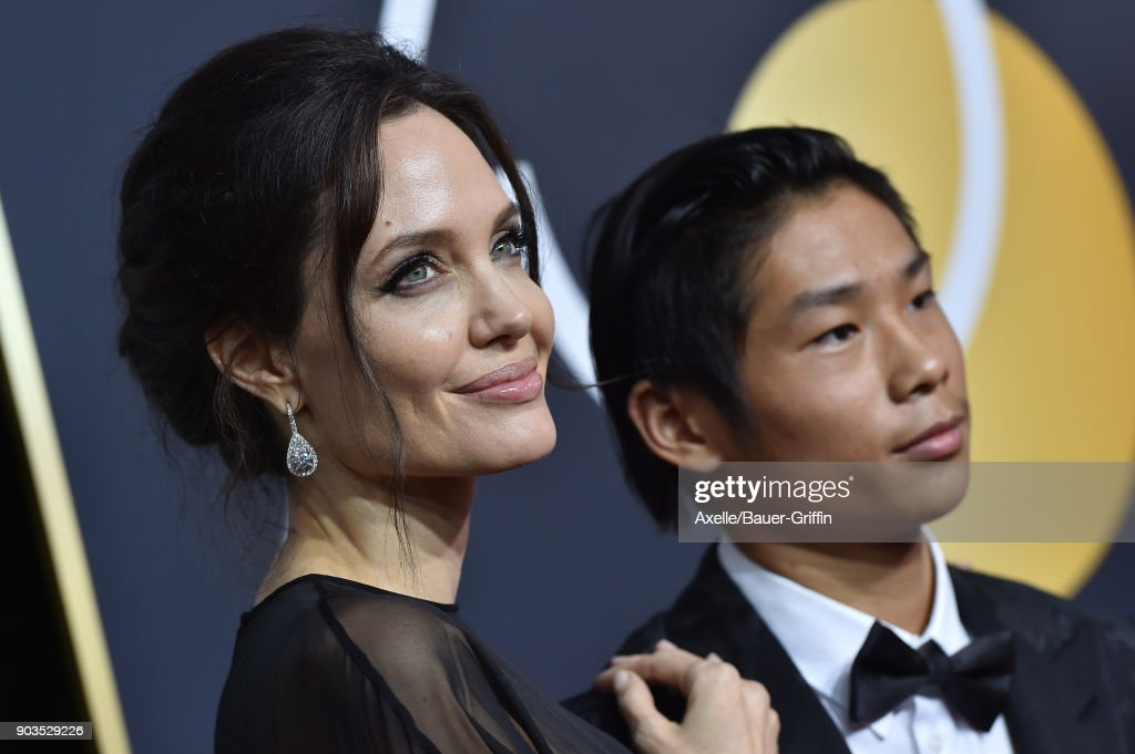 Actress Angelina Jolie and son Pax Thien Jolie-Pitt attend the 75th Annual Golden Globe Awards at The Beverly Hilton Hotel on January 7, 2018 in Beverly Hills, California.