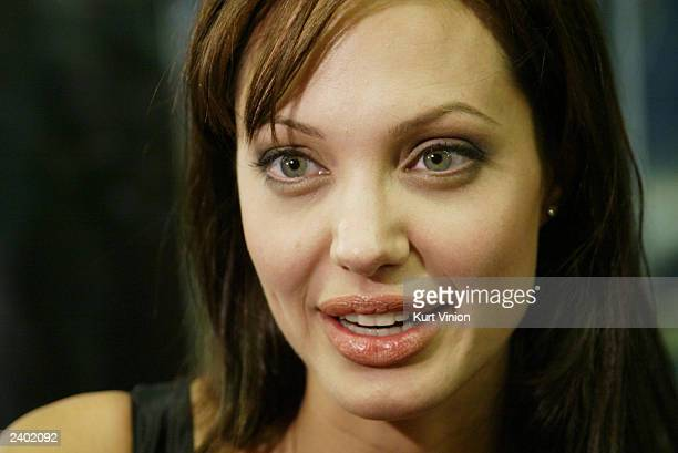 Actress Angelina Jolie answers questions at the premiere of her new film 'Lara Croft Tomb Raider The Cradle of Life' on August 13 2003 in Munich...