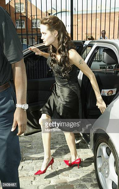 Actress Angelina Jolie arrives at the MTV TRL studio for an appearance to promote her new film 'Lara Croft Tomb Raider The Cradle Of Life' August 19...