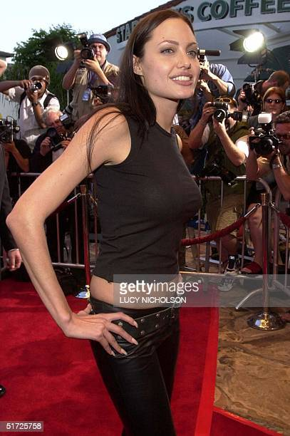 US actress Angelina Jolie arrives at the premiere of her new film 'Lara Croft Tomb Raider' in Los Angeles 11 June 2001 AFP PHOTO/Lucy NICHOLSON