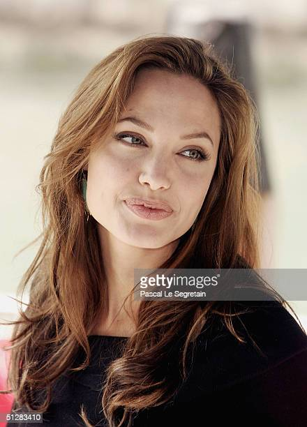 Actress Angelina Jolie arrives for the 'Shark Tail' photocall at the 61st Venice Film Festival on September 10 2004 in Venice Italy
