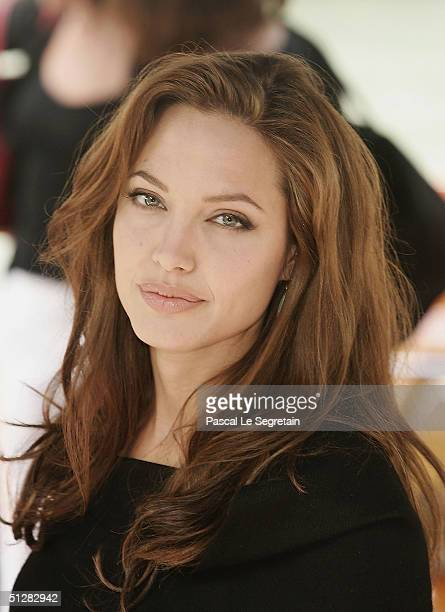 Actress Angelina Jolie arrives for the 'Shark Tale' Photocall at the 61st Venice Film Festival on September 10 2004 in Venice Italy