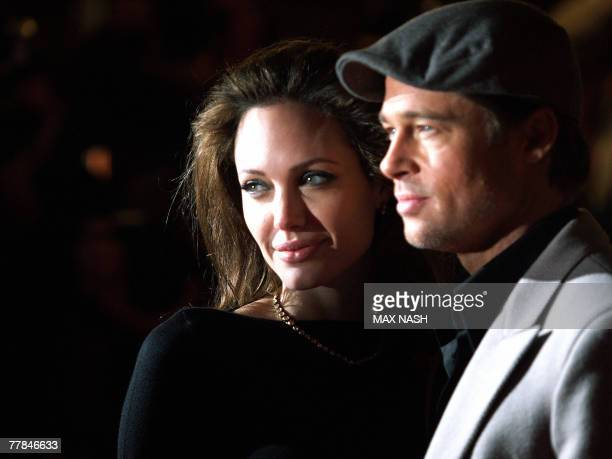 US actress Angelina Jolie arrives with actor Brad Pitt in London's Leicester Square 11 November 2007 to attend the European Premiere of her latest...