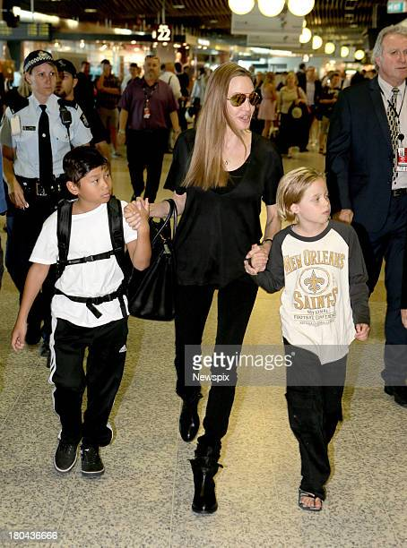 Actress Angelina Jolie arrives with children Pax JoliePitt and Shiloh JoliePitt at Brisbane Domestic Airport on September 12 2013 in Brisbane...