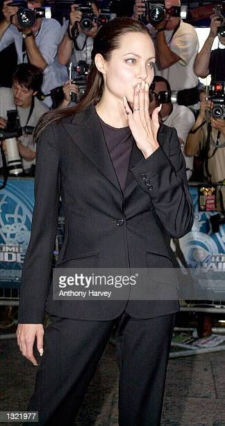 Actress Angelina Jolie blows a kiss to the crowd as she arrives for the premiere of 'Tomb Raider' July 03 2001 in London