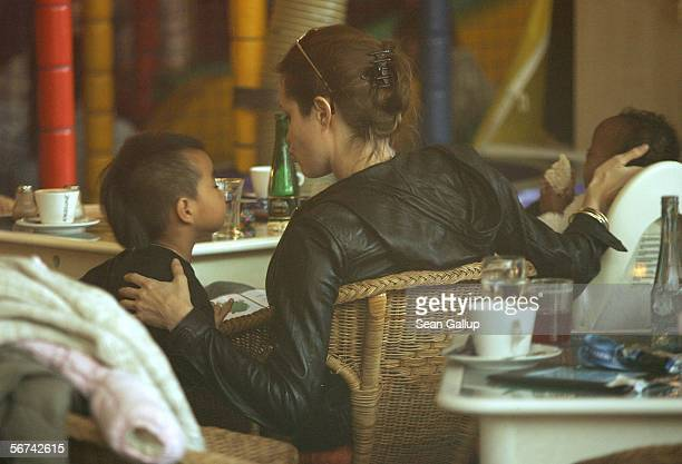 Actress Angelina Jolie caresses her adopted children Maddox and Zahara while having lunch with boyfriend Brad Pitt February 4 2006 at Pups family...