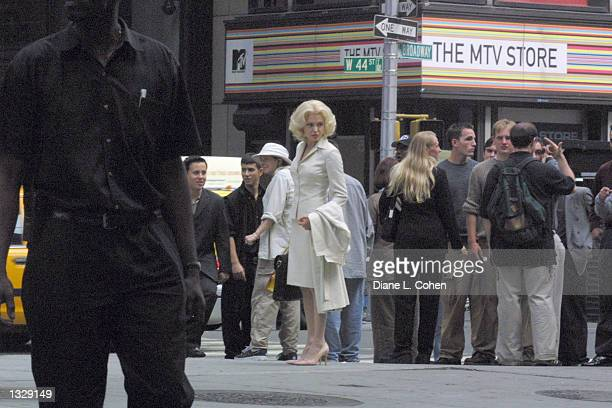 Actress Angelina Jolie center waits during filming on the set of the movie 'Life or Something Like It' July 1 2001 in Times Square in New York City...