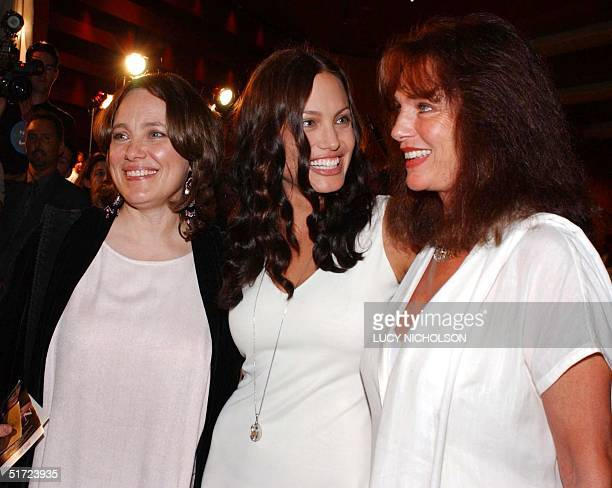US actress Angelina Jolie chats with her mother Marcheline Bertrand and British actress Jacqueline Bisset at the premiere of her new film Original...