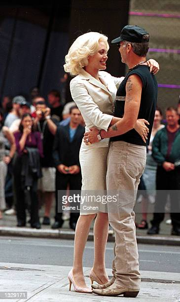 Actress Angelina Jolie embraces her husband Billy Bob Thornton during a break in filming on the set of the movie 'Life or Something Like It' July 1...