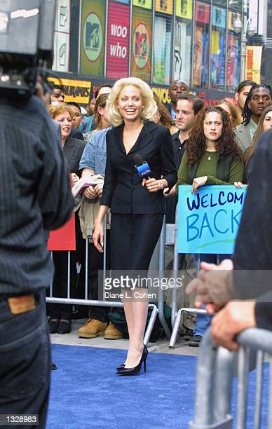 Actress Angelina Jolie films a scene on the movie set of 'Life or Something Like It' June 30 2001 in Times Square in New York City Jolie stars as a...
