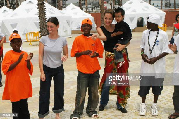Actress Angelina Jolie holding adopted son Maddox poses for photographers in her role as Goodwill Ambassador of the United Nations High Commissioner...