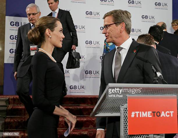 Actress Angelina Jolie in her role as UN envoy talks to German Foreign Minister Guido Westerwelle following a news conference regarding sexual...