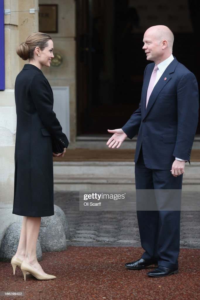 Actress Angelina Jolie is greeted by British Foreign Secretary William Hague at Lancaster House before attending the G8 Foreign Ministers' conference on April 11, 2013 in London, England. G8 Foreign Ministers are holding a two day meeting where they will discuss the situation in the Middle East; including Syria and Iran, security and stability across North and West Africa, Democratic People's Republic of Korea and climate change. British Foreign Secretary William Hague will also highlight five key policy priorities.