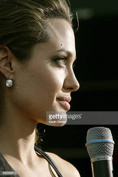 Actress Angelina Jolie is interviewed as she arrives at the premiere of 'Mr Mrs Smith' at the Mann Village Theater on June 7 2005 in Westwood...