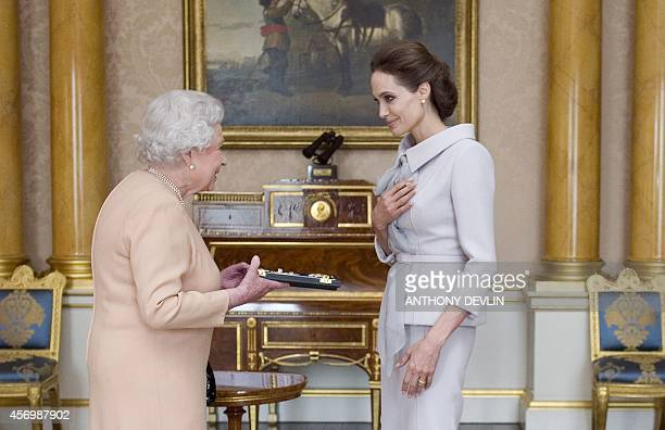 US actress Angelina Jolie is presented with the Insignia of an Honorary Dame Grand Cross of the Most Distinguished Order of St Michael and St George...