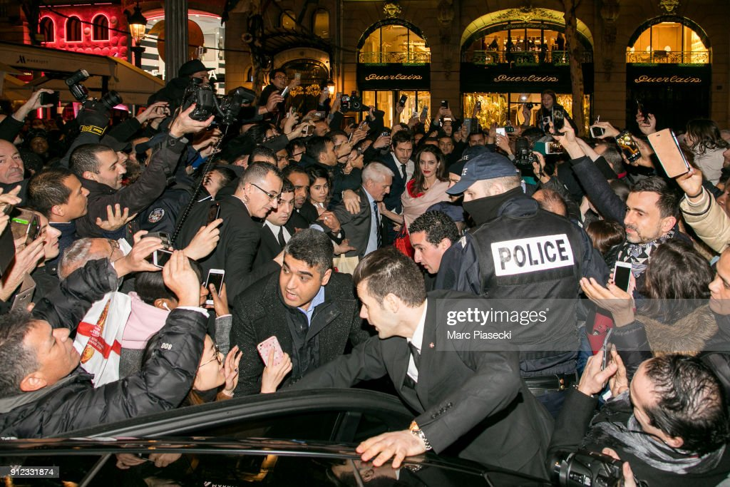 Actress Angelina Jolie is surrounded by the crowd as she leaves the 'Guerlain' store on the Champs-Elysees avenue on January 30, 2018 in Paris, France.