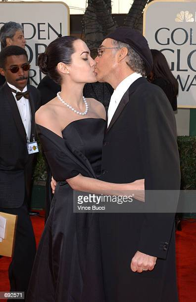 Actress Angelina Jolie kisses her husband actor Billy Bob Thornton as they attend the 59th Annual Golden Globe Awards at the Beverly Hilton Hotel...