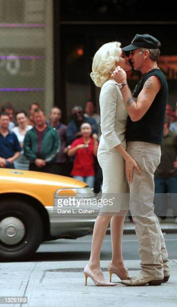 Actress Angelina Jolie kisses her husband Billy Bob Thornton during a break in filming on the set of the movie 'Life or Something Like It' July 1...