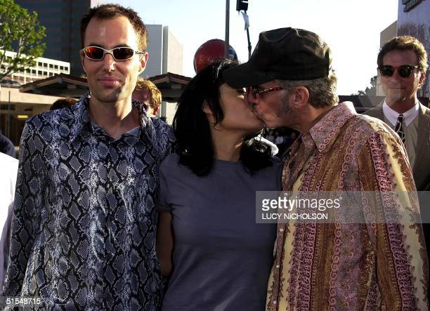 US actress Angelina Jolie kisses her new husband actor/director Billy Bob Thornton as she arrives at the premiere of her new film 'Gone in 60...