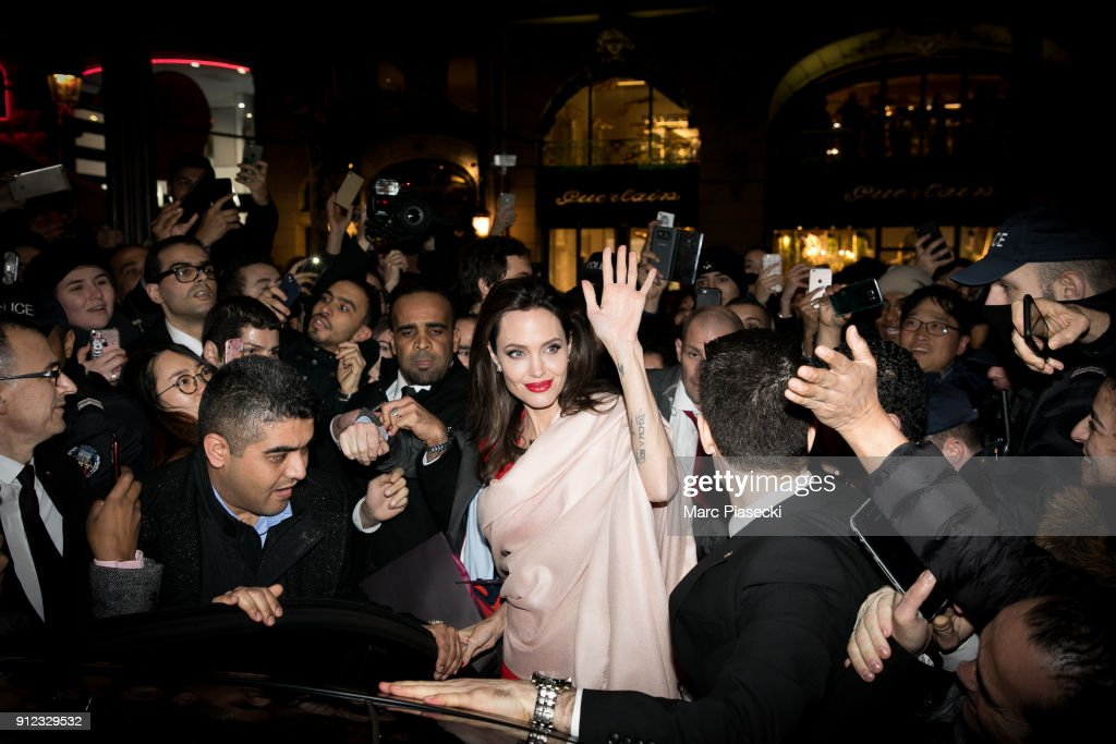 Actress Angelina Jolie leaves the 'Guerlain' store on the Champs-Elysees avenue on January 30, 2018 in Paris, France.