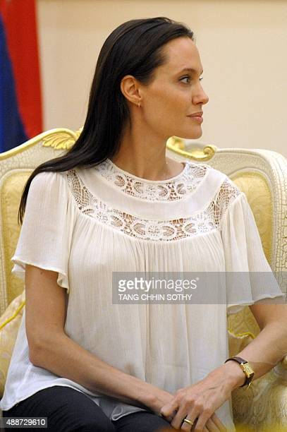 US actress Angelina Jolie listens to Cambodian Prime Minister Hun Sen during a meeting at the Peace Palace in Phnom Penh on September 17 2015...