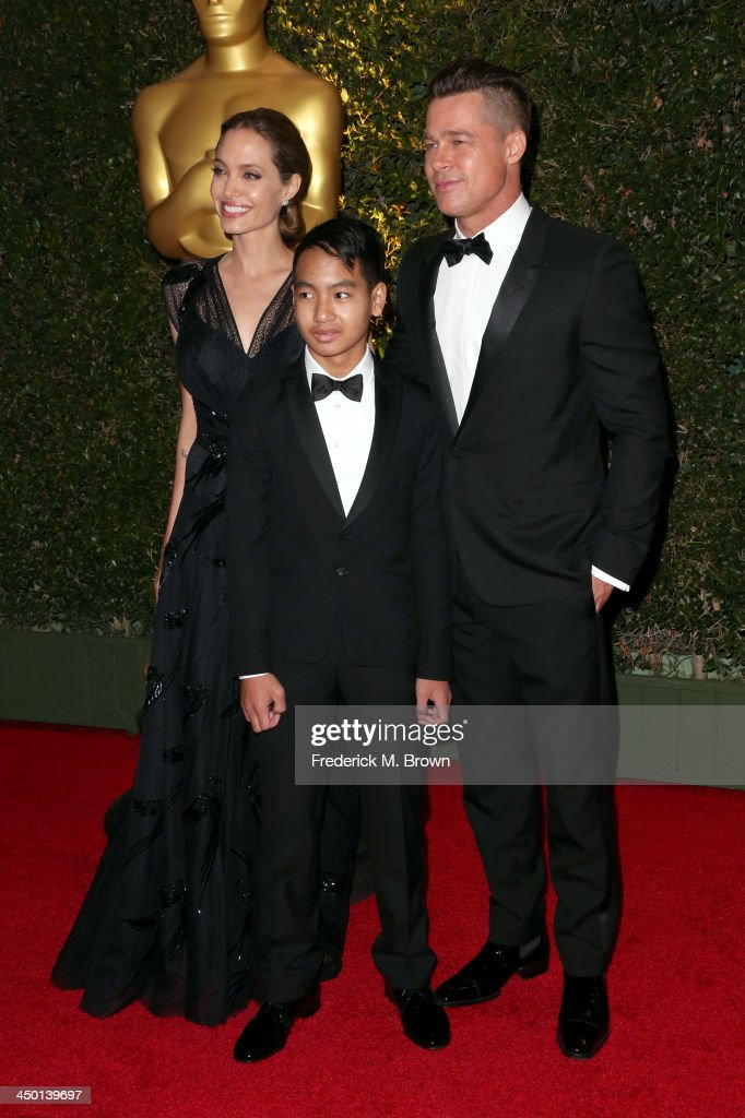 Actress Angelina Jolie, Maddox Jolie-Pitt and actor Brad Pitt arrive at the Academy of Motion Picture Arts and Sciences' Governors Awards at The Ray Dolby Ballroom at Hollywood & Highland Center on November 16, 2013 in Hollywood, California.