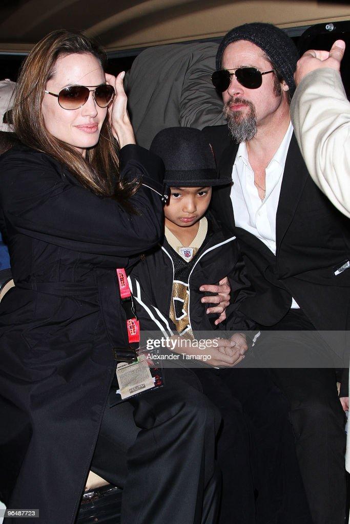 Actress Angelina Jolie, Maddox Jolie-Pitt and actor Brad Pitt leave Super Bowl XLIV at the Sun Life Stadium on February 7, 2010 in Miami Gardens, Florida.