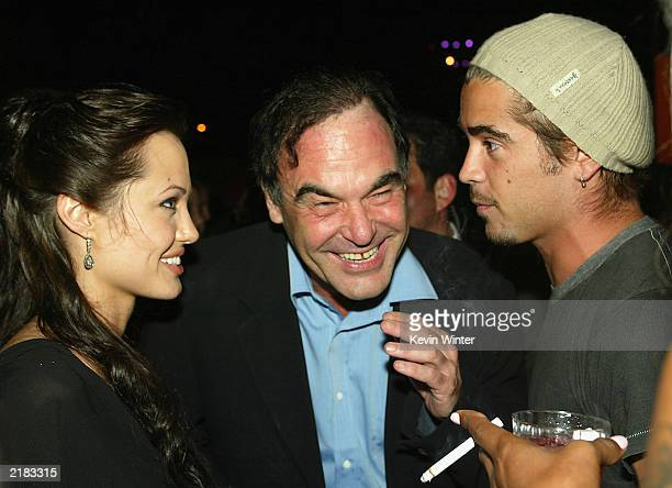 Actress Angelina Jolie Oliver Stone and Colin Farrell talk at the afterparty for the premiere of Lara Croft Tomb Raider The Cradle of Life on July 21...