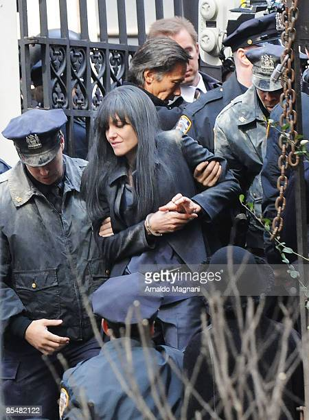 Actress Angelina Jolie perfoms during the filming of 'Salt' outside the Waldorff Astoria March 18 2009 in New York City