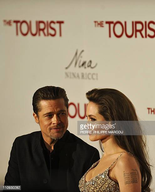 """Actress Angelina Jolie poses as she arrives with US actor Brad Pitt for the premiere of her last film """"the Tourist"""" on December 16, 2010 at the..."""