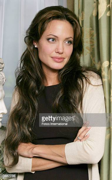 OUT*** Actress Angelina Jolie poses backstage at a press junket for her new film 'Beyond Border' at the Dorchester Hotel October 12 2003 in London...