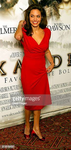 Actress Angelina Jolie poses for photographs at the photocall for 'Alexander' at the Dorchester Hotel on January 5 2005 in London England
