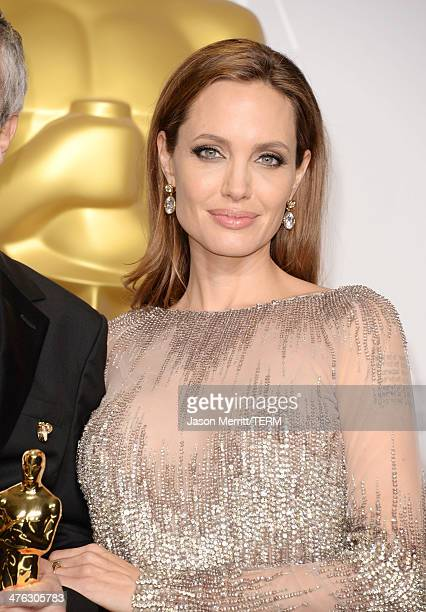 Actress Angelina Jolie poses in the press room during the Oscars at Loews Hollywood Hotel on March 2 2014 in Hollywood California