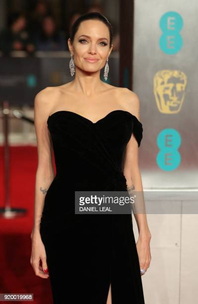 US actress Angelina Jolie poses on the red carpet upon arrival at the BAFTA British Academy Film Awards at the Royal Albert Hall in London on...