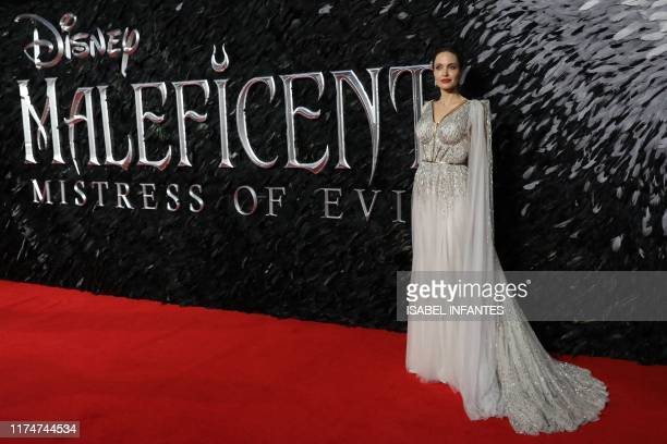 US actress Angelina Jolie poses on the red carpet upon arrival for the European premiere of the film MaleficentMistress of Evil in London on October...