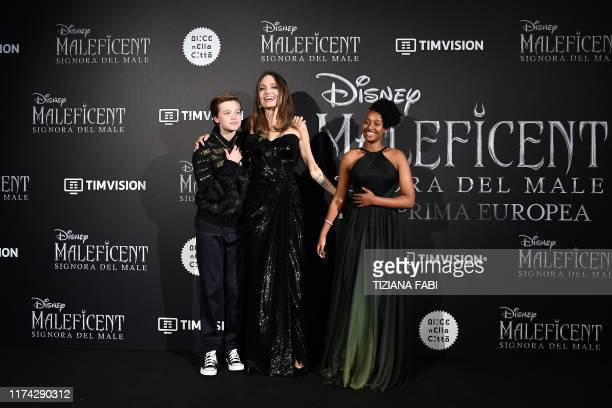 US actress Angelina Jolie poses with her children Shiloh Nouvel JoliePitt and Zahara Marley JoliePitt during the European premiere of Disney's dark...