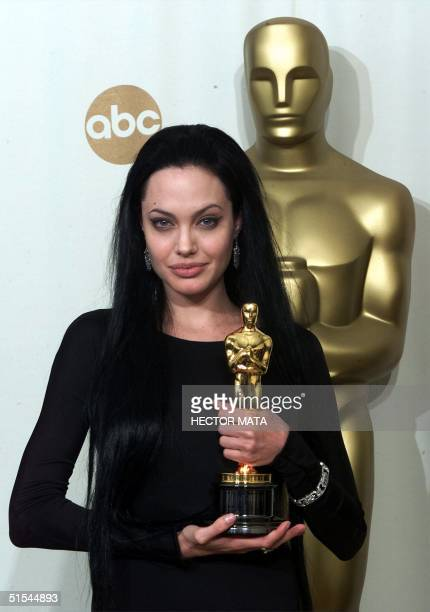 Actress Angelina Jolie poses with her Oscar for Best Supporting Actress for her role 'Girl Interrupted' at the 72nd Annual Academy Awards in Los...