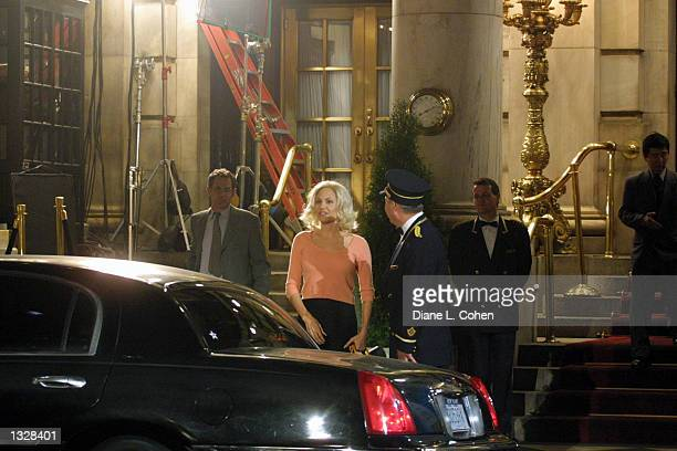Actress Angelina Jolie second left works on the set of the movie 'Life or Something Like It' June 28 2001 in front of the Plaza Hotel in New York City
