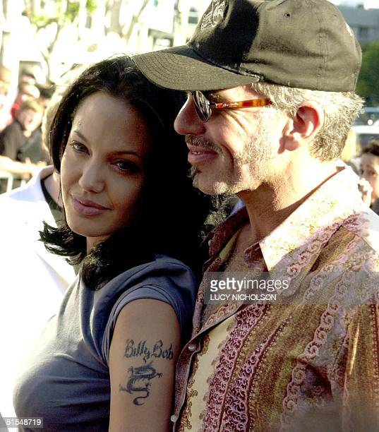 US actress Angelina Jolie shows off her new tattoo as she arrives at the premiere of her new film 'Gone in 60 Seconds' with her new husband...