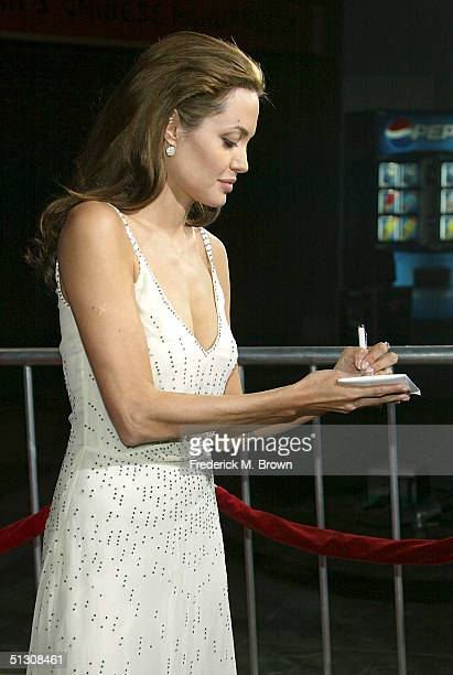 Actress Angelina Jolie signs autographs at the world premiere of 'Sky Captain And The World of Tomorrow' at the Grauman's Chinese Theatre on...