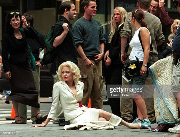 Actress Angelina Jolie sit on the ground between takes during the filming of a scene in the movie 'Life or Something Like It' July 1 2001 in Times...