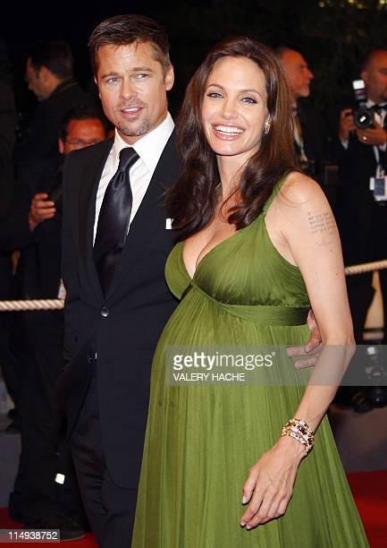 US actress Angelina Jolie smiles as she leaves the festival Palace with her partner and actor Brad Pitt after attending the screening of US directors...