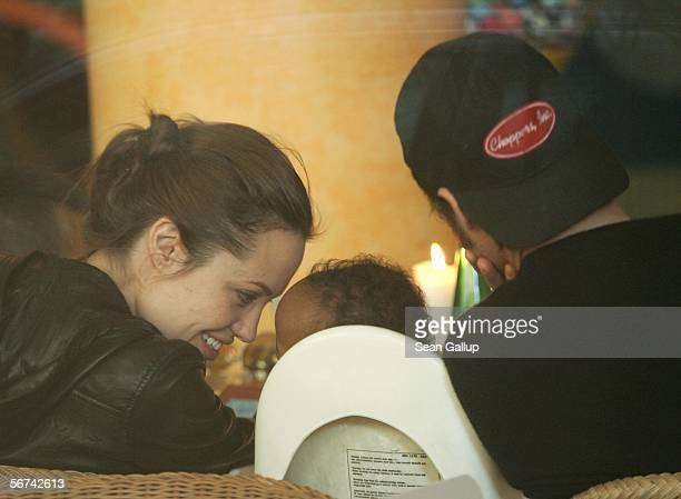 Actress Angelina Jolie snuggles with her adopted child Zahara while having lunch with boyfriend actor Brad Pitt and her other child Maddox February 4...