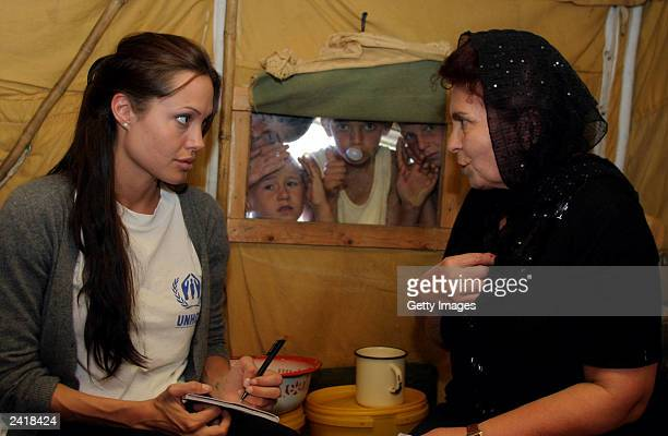 Actress Angelina Jolie talks with Chechen refugees in 'Bella' refugee camp during her visit in Ingushetia August 22 in Ingushetia Russia Jolie a...