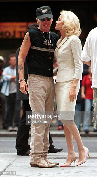 Actress Angelina Jolie talks with her husband Billy Bob Thornton during a break in filming on the set of the movie 'Life or Something Like It' July 1...